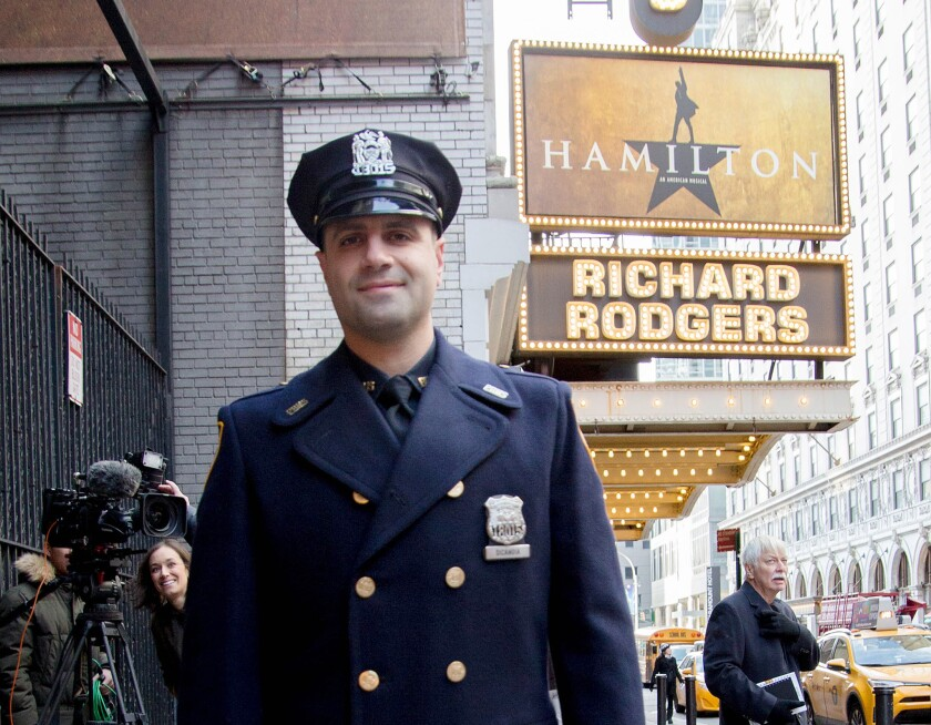 "Officer Ricardo DiCandia outside the Richard Rodgers Theatre on Wednesday. DiCandia saved the day for two tourists when he helped cover the bill for them to see the Broadway hit ""Hamilton."""