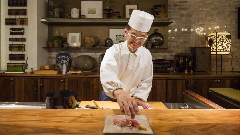 Chef Hiroyuki Naruke, from Tokyo, Japan, preparing a plate of Toro at Q Sushi in downtown Los Angeles.