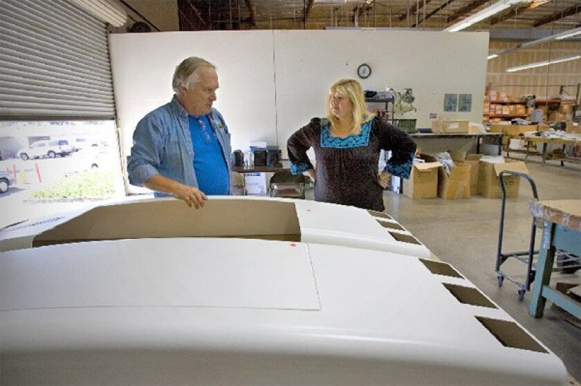 Cathy and Bruce Jamieson, who run American Design, are struggling to provide their employees with affordable health insurance. (Nelvin C. Cepeda / Union-Tribune)