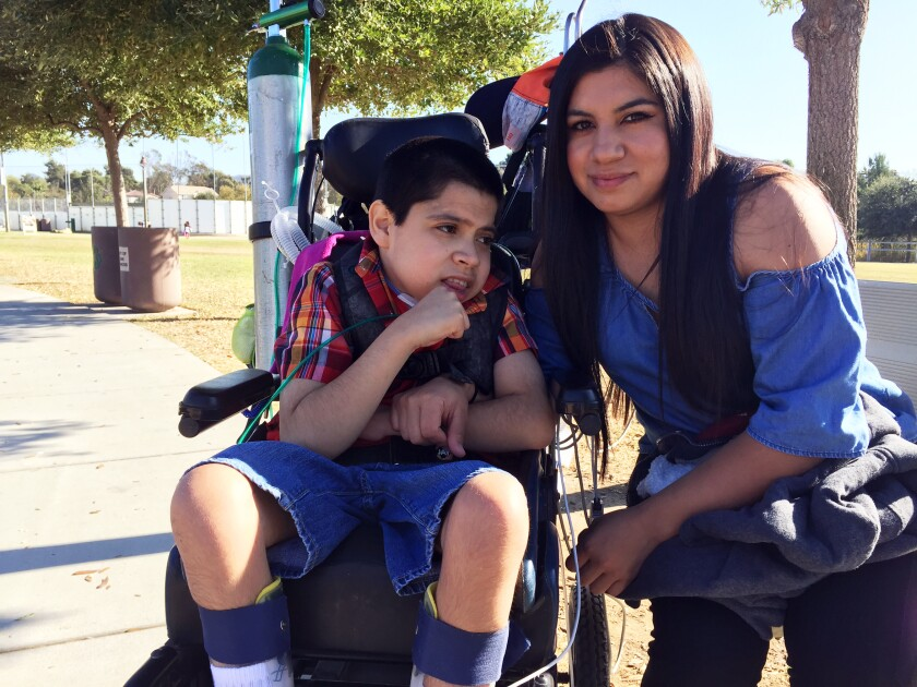 Izaiah Wallis, 10, of Vista, cuddles with his mom, Lucy Verde, 30, at Sunset Park in San Marcos on Sunday, Nov. 3.