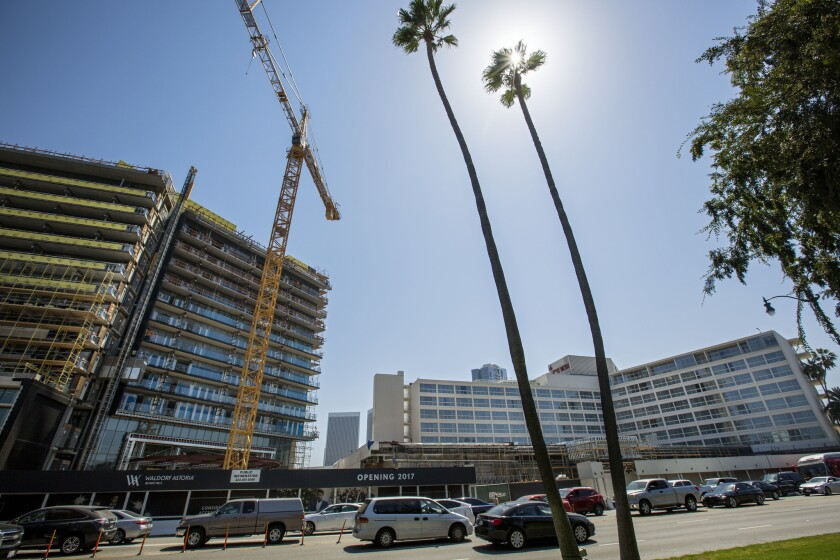 Ongoing construction in Beverly Hills. Plans to erect the city's tallest building ever have pitted two deep-pocketed developers against each other.