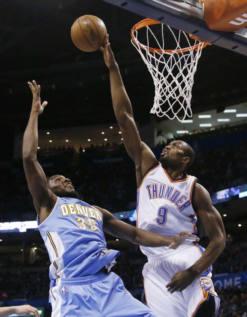Oklahoma City Thunder forward Serge Ibaka (9) blocks a shot by Denver Nuggets forward Kenneth Faried (35) in the first quarter of an NBA basketball game in Oklahoma City, Sunday, Feb. 22, 2015. (AP Photo/Sue Ogrocki)