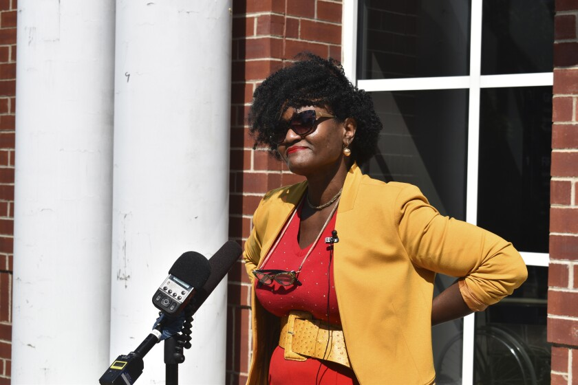 Adirondack Diversity Initiative Director Nicole Hylton-Patterson addresses the media during a news conference outside the Essex County Courthouse in Elizabethtown, N.Y., on Thursday, Aug. 6, 2020. Hylton-Patterson, who became the first-ever director of the Adirondack Diversity Initiative in December 2019, moved to the Adirondack Mountains to try to make this vast and overwhelmingly white region more welcoming to people like her. (Elizabeth Izzo/Adirondack Daily Enterprise via AP)