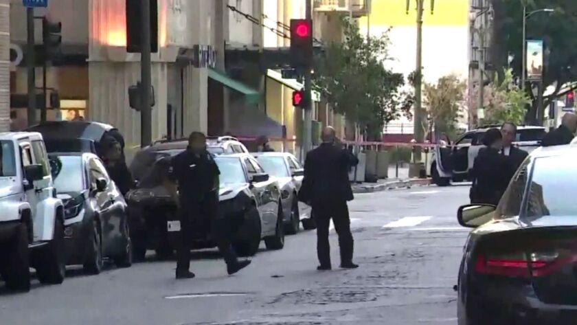 Police investigate the scene of an officer-involved shooting Sunday in downtown L.A.