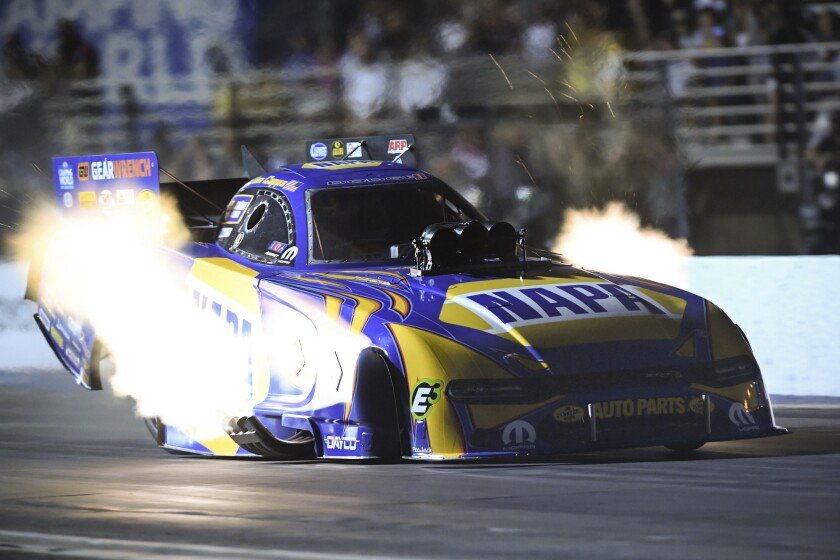 In this photo provided by the NHRA, Ron Capps drives in Funny Car qualifying.