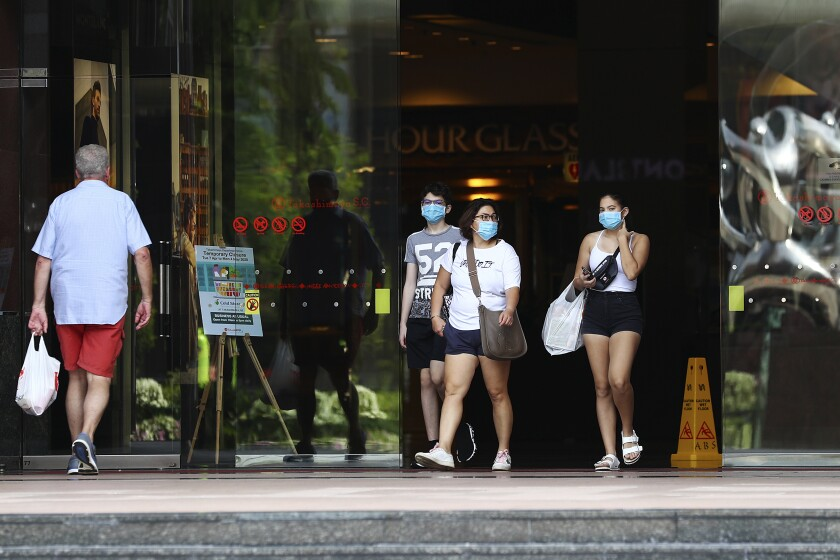 Shoppers leave a mall along Singapore's Orchard Road in April.