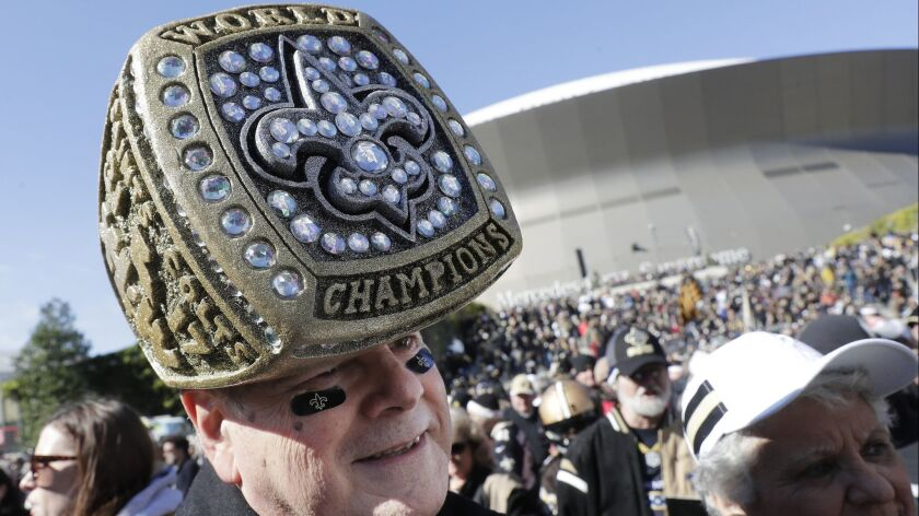 New Orleans Saints fan Dave Perry arrives before the NFL football NFC championship game against the
