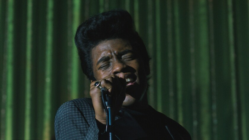 "Chadwich Boseman as James Brown in a scene from ""Get on Up."""