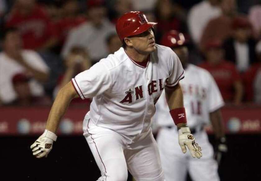 In 2006, Tim Salmon watches one of the 299 home runs he hit for the Angels.