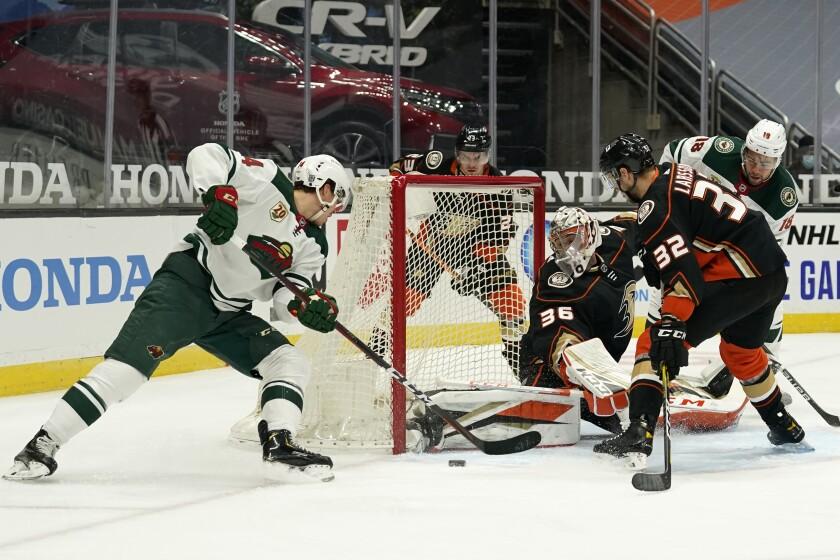 Ducks goaltender John Gibson stops a shot from Minnesota Wild center Joel Eriksson Ek.