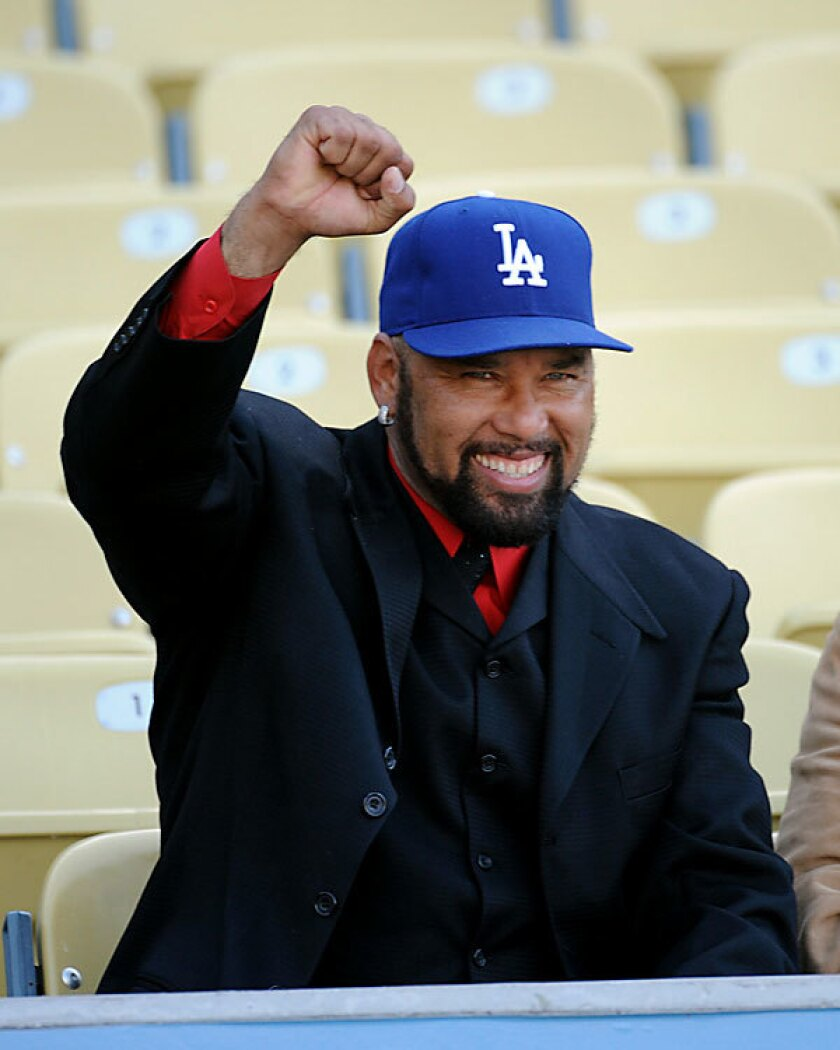 Former Los Angeles Dodgers pitcher Jose Lima is seen before the start of Friday's game against the Detroit Tigers at Dodger Stadium. He died Sunday of an apparent heart attack at his home in Pasadena, Dan Evans, Lima's agent, told The Times. He was 37.