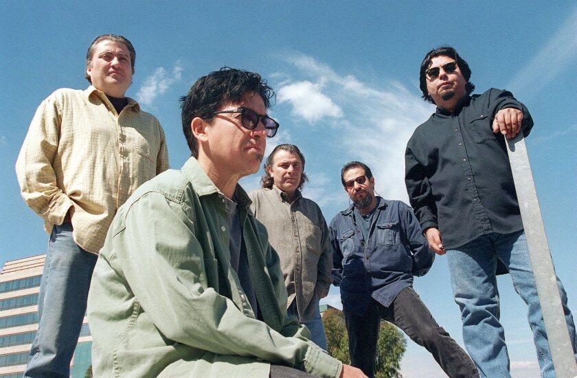 Los Lobos -- David Hidalgo, Louie Perez, Conrad Lozano, Steve Berlin and Cesar Rosas -- at Warner Records in Burbank on March 1, 1996.