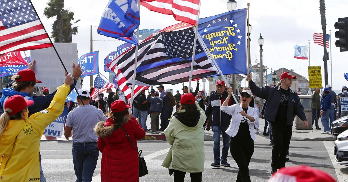 As election win is projected for Joe Biden, people demonstrate in Huntington Beach