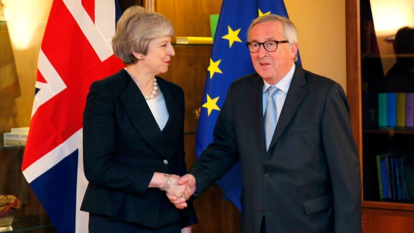 British Prime Minister Theresa May meets with European Commission President Jean-Claude Juncker on Monday at the European Parliament in Strasbourg, France.