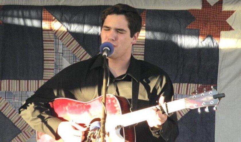 Zach Caplinger plays guitar for Next Generation.