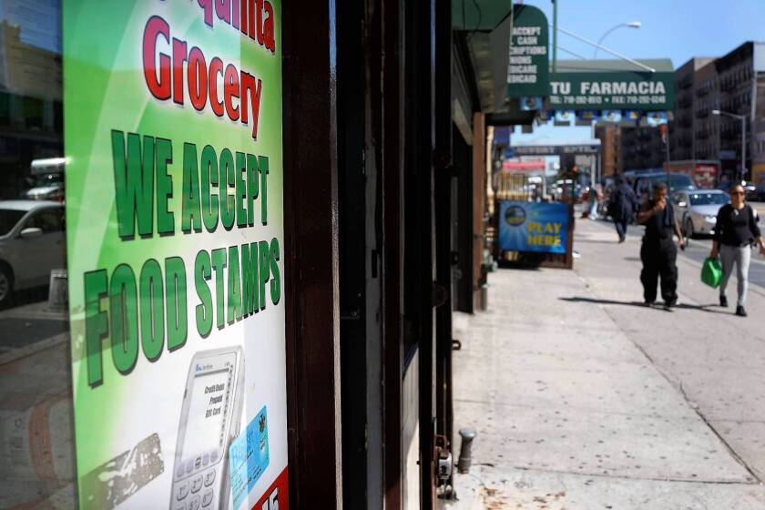 A store advertises it accepts food stamps