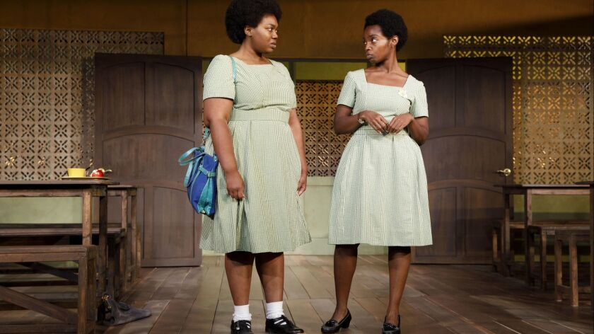 Abena Mensah-Bonsu, left, and MaameYaa Boafo in the MCC Theater production of 'School Girls; Or, the African Mean Girls Play,' now at the Kirk Douglas Theatre.