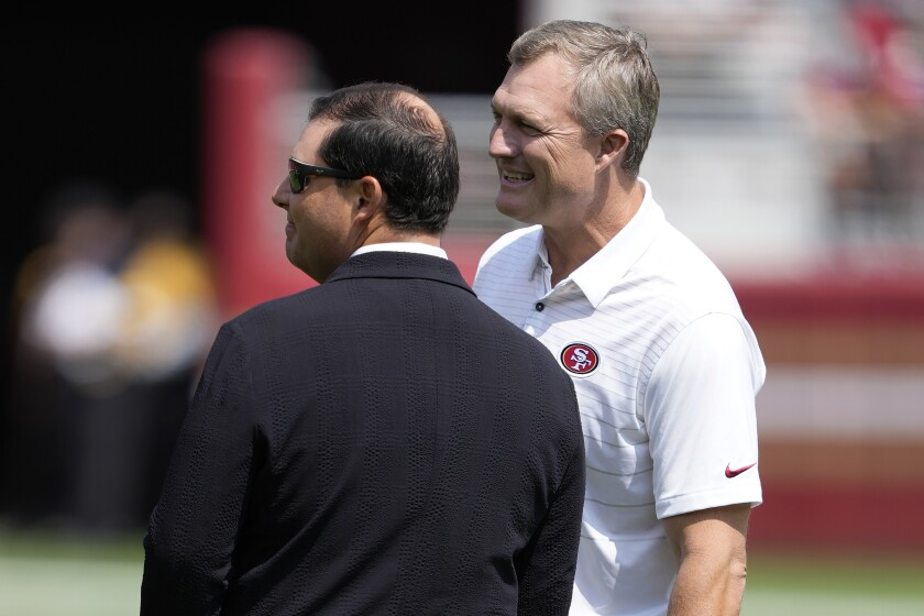San Francisco 49ers GM John Lynch (right) talks with team owner Jed York before exhibition game last month.