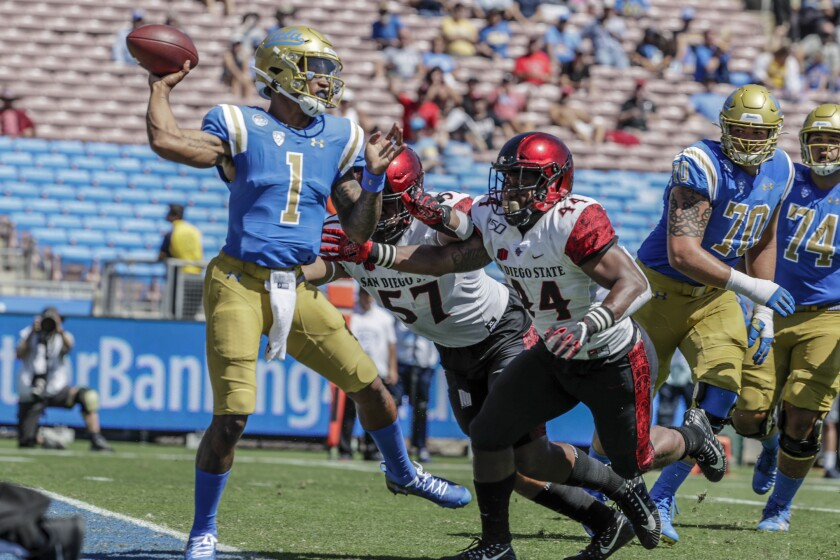 UCLA QB Dorian Thomposon-Robinson unloads while evading the San Diego State rush last Saturday at the Rose Bowl.