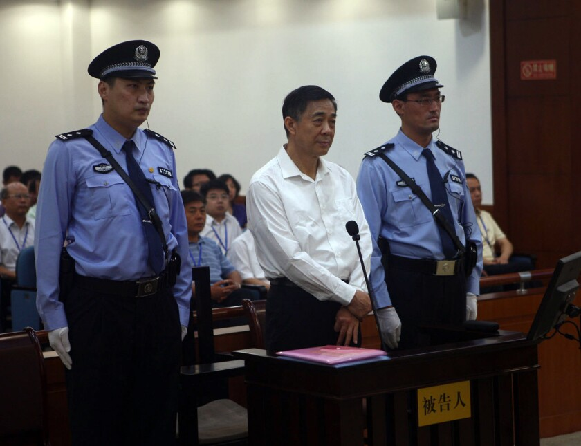 Bo Xilai, center, in court. He said he wrongly confessed last year to a disciplinary panel of the Communist Party without fully understanding the charges against him.