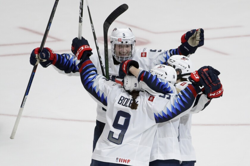 U.S. players celebrate the game-winning overtime goal by Megan Bozek (9) in their 4-3 win over Canada on Feb. 8, 2020, at Honda Center.