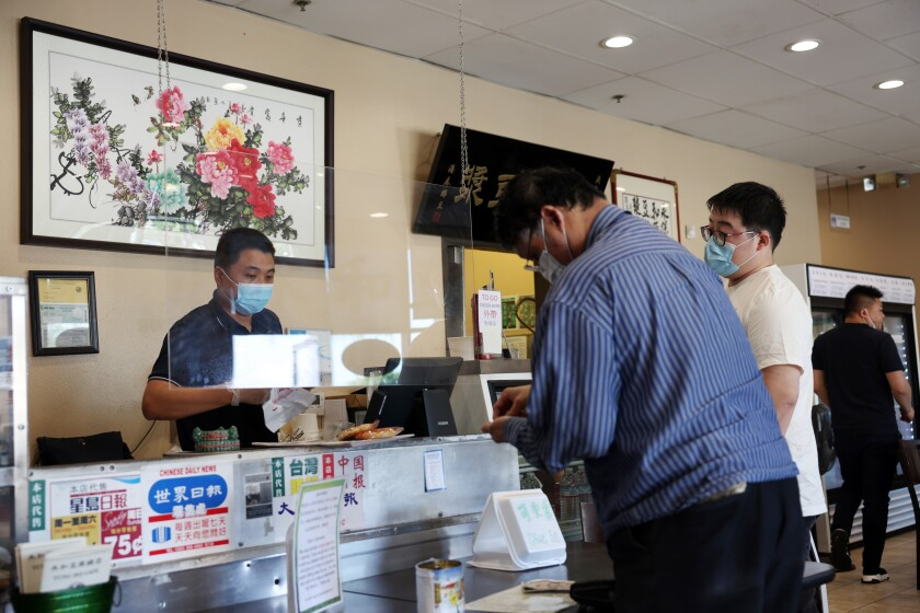 Customers order their food at YungHo cafe along Valley Boulevard, a magnet for families who like buns, sweet rolls and mochi.