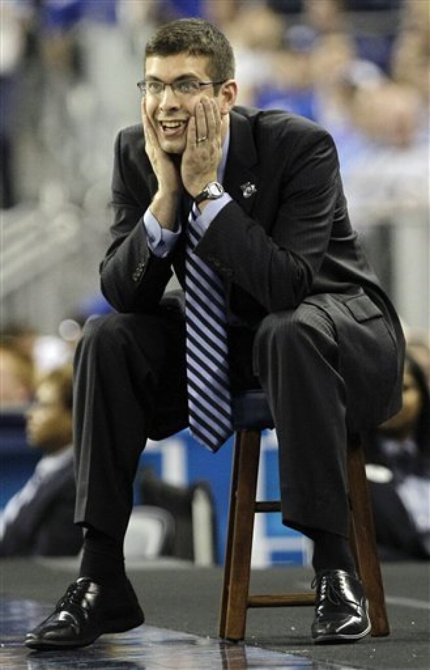 Butler head coach Brad Stevens reacts to action against Virginia Commonwealth during the second half of a men's NCAA Final Four semifinal college basketball game Saturday, March 2, 2011, in Houston. (AP Photo/Eric Gay)