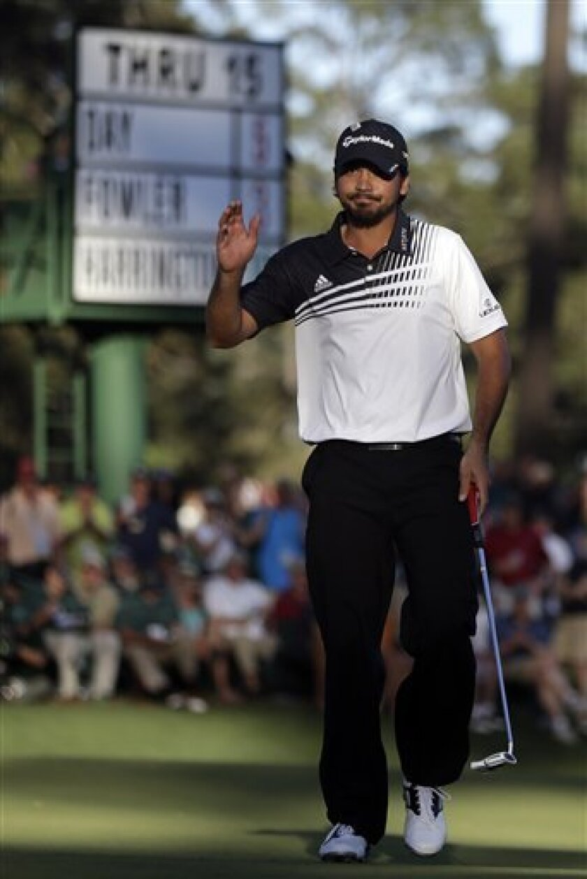 Jason Day, of Australia, waves after a birdie putt on the 16th green during the second round of the Masters golf tournament Friday, April 12, 2013, in Augusta, Ga. (AP Photo/David Goldman)