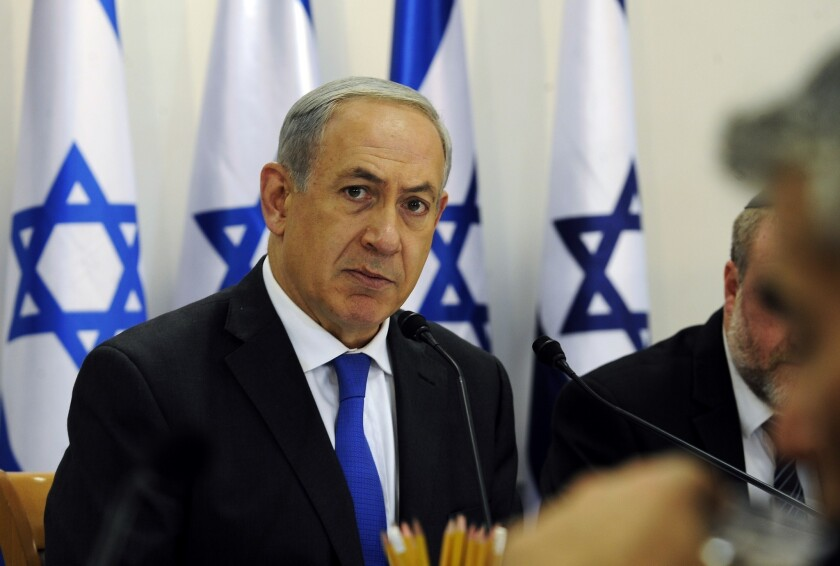 "Israeli Prime Minister Benjamin Netanyahu looks on during a cabinet meeting. Netanyahu said that Israel would do all it could to keep world powers from striking a ""bad and dangerous"" deal with Iran over its nuclear program."