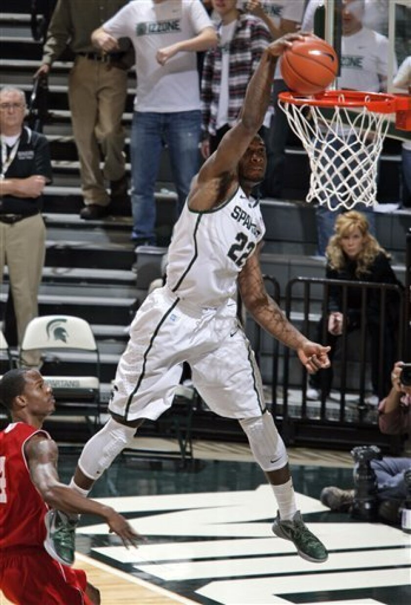 Michigan State's Branden Dawson (22) dunks in front of Nicholls State's Jeremy Smith after a steal and fast break during the first half of an NCAA college basketball game, Saturday, Dec. 1, 2012, in East Lansing, Mich. (AP Photo/Al Goldis)