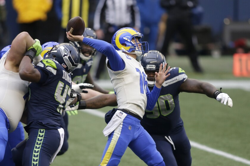 Rams quarterback Jared Goff passes under pressure from the Seahawks defense.