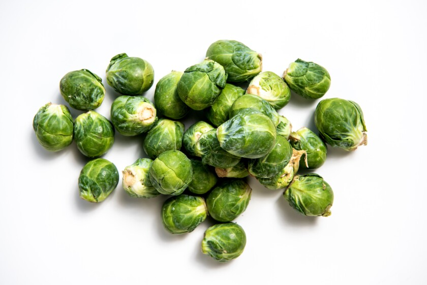 Whole, raw Brussels sprouts