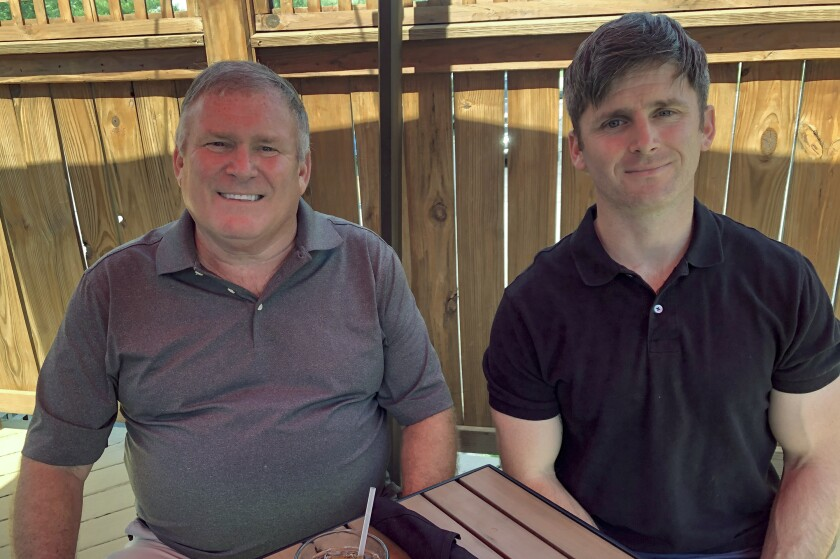 Baby Boomer Buck Newsome, left, lunches with son, Chris Newsome, a Millennial, in Newtown, Ohio.
