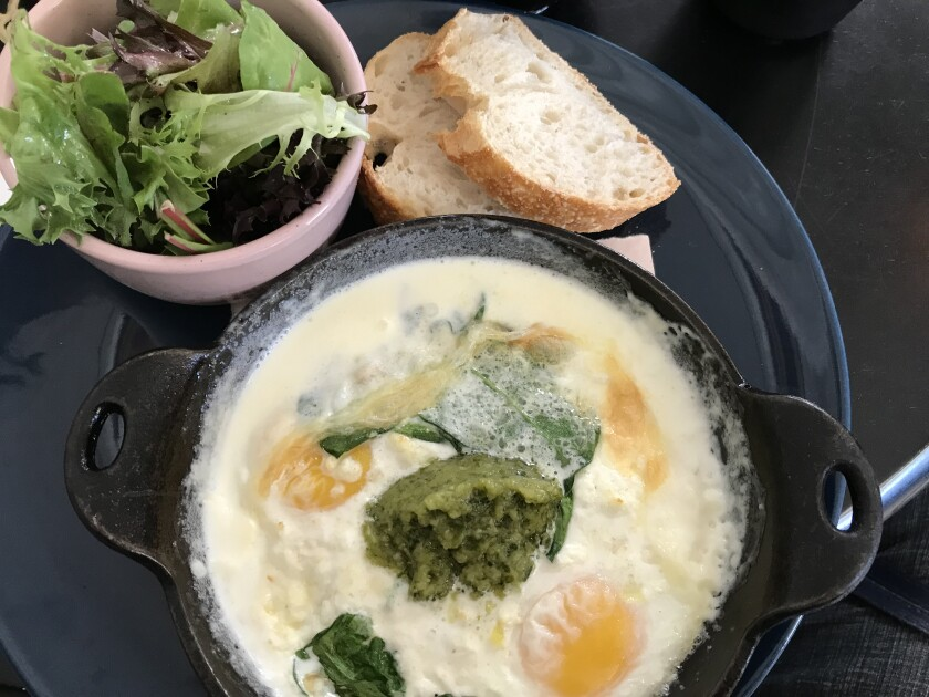 The baked green eggs dish at Little Lion cafe in Point Loma.