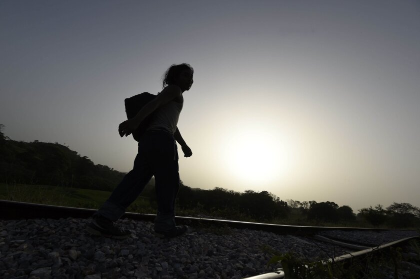 A migrant walks in Chiapas state, Mexico, in June 2015. Hundreds of Central American migrants enter Mexico on their way to the United States.