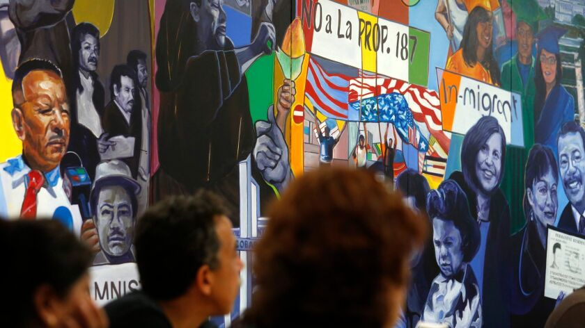 People listen during a CHIRLA immigration rights workshop in Los Angeles.