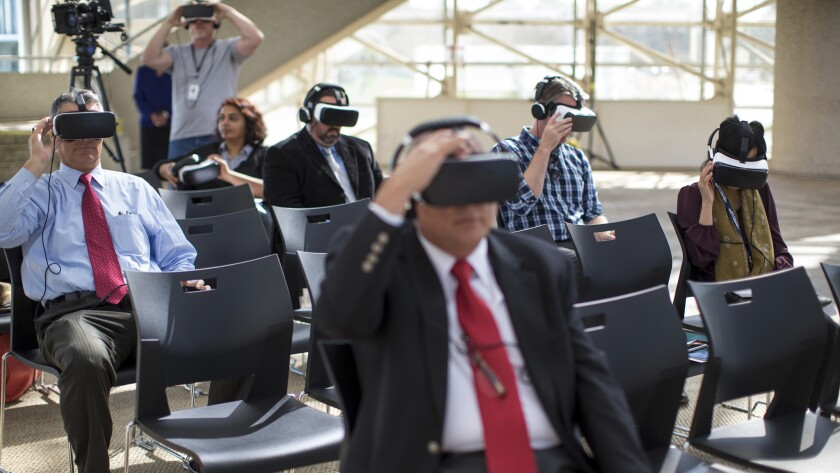Invited guests and media watch a virtual reality tour of the multimillion-dollar renovation of the Christ Cathedral on Wednesday in Garden Grove.