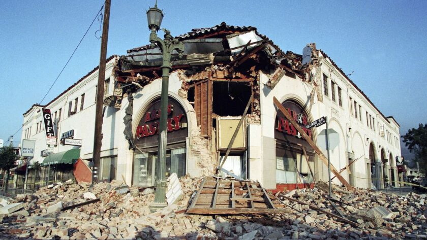 FILE - This Jan. 17, 1994 file photo shows bricks and debris surrounding a building housing Ara's Pa