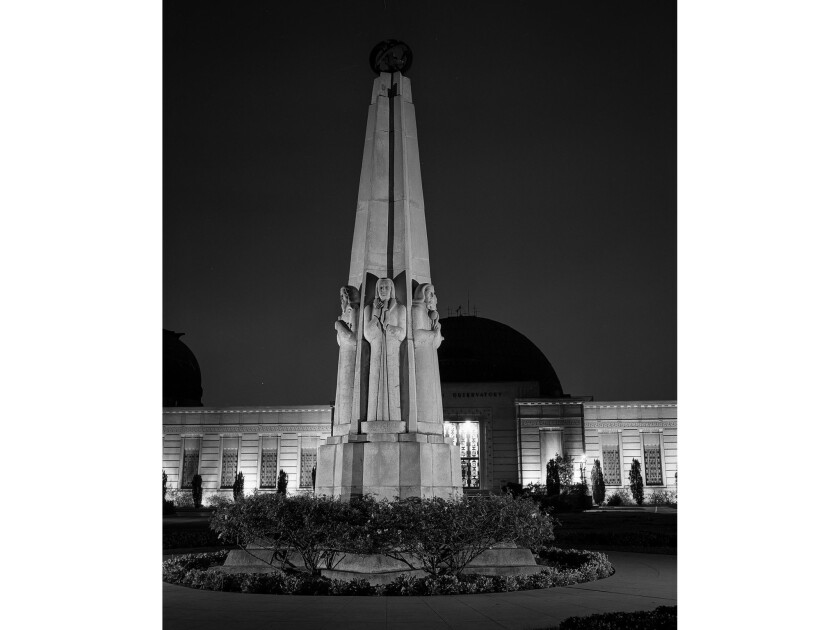 Nov. 18, 1955: The Astronomers Monument sits right outside the entrance to Los Angeles' Griffith Observatory.