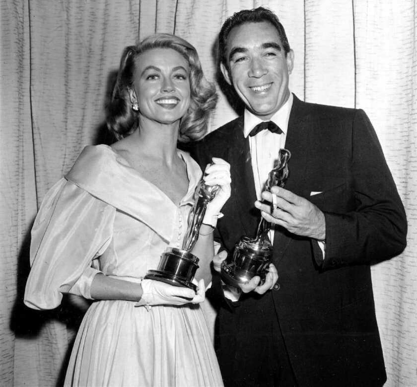 """Anthony Quinn, who was born in Mexico, won two Academy Awards for supporting actor. He's pictured at the Oscars on March 27, 1957 with Dorothy Malone. Quinn won for """"Lust for Life"""" and Malone received her Oscar for """"Written on the Wind."""""""