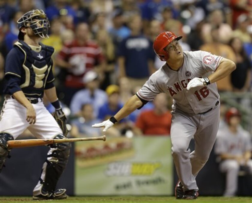 Los Angeles Angels' Hank Conger, right, watches his two RBI home run against the Milwaukee Brewers during the ninth inning of a baseball game, Saturday, Aug. 31, 2013, in Milwaukee. (AP Photo/Jeffrey Phelps)