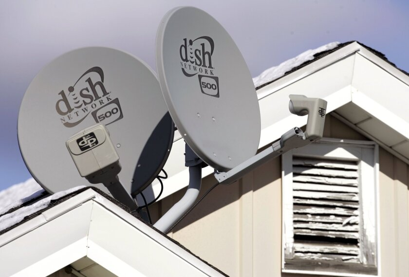 In this November 2008 photo, Dish Network satellite dishes are attached to a home in Buffalo, N.Y. A federal judge ruled in January that the service's automatic TV recording, remote streaming and commercial skipping features did not violate Fox Broadcasting's copyrights, although some of the features did violate Dish's contracts with Fox.