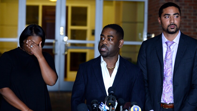 Justin Bamberg, right, with Rachel and Ray Dotch, sister-in-law and brother-in-law to Keith Lamont Scott, at a news conference in Charlotte, N.C.