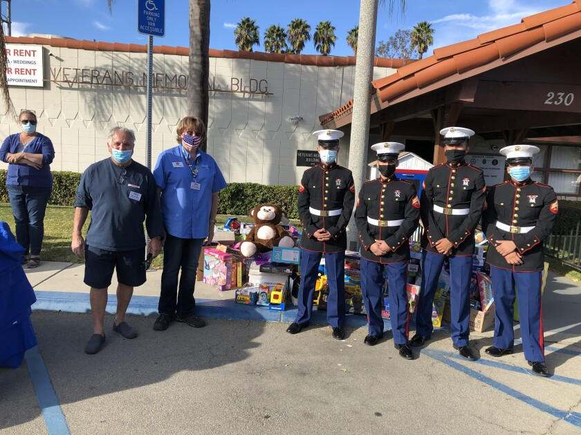 Nancy Wasco, Steve Gardella , Gina Roberts, four United States Marines from the local reserve unit.