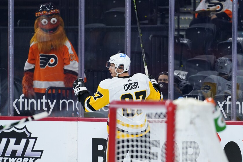 Pittsburgh Penguins' Sidney Crosby celebrates after scoring a goal during the second period of an NHL hockey game against the Philadelphia Flyers, Tuesday, May 4, 2021, in Philadelphia. (AP Photo/Matt Slocum)