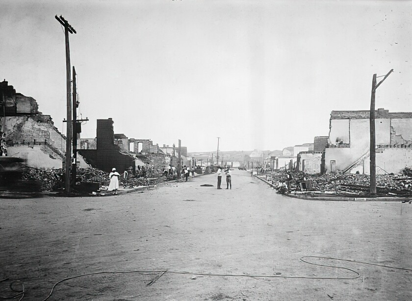 A street in Tulsa, Okla., with buildings on both sides reduced to rubble.