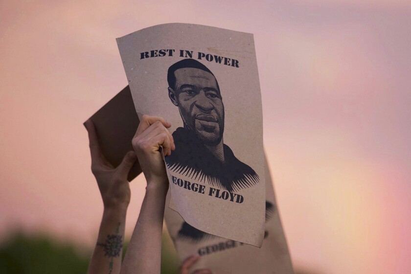 A sign featuring an image of George Floyd is held during a protest in Minneapolis on May 27.