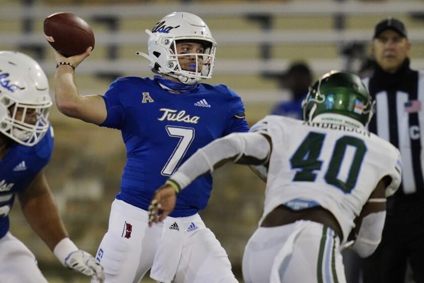Tulsa quarterback Davis Brin (7) throws a pass while under pressure from Tulane linebacker Nick Anderson (40) during the second half of an NCAA college football game in Tulsa, Okla., Thursday, Nov. 19, 2020. (AP Photo/Sue Ogrocki)