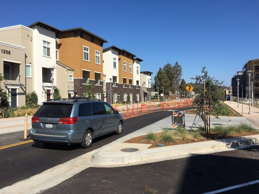A van travels east on Armorlite Drive in San Marcos where a project to transform the street into a pedestrian-friendly, transit-oriented area is wrapping up.
