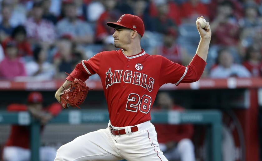 Angels starter Andrew Heaney throws a pitch against the Astros on July 16.